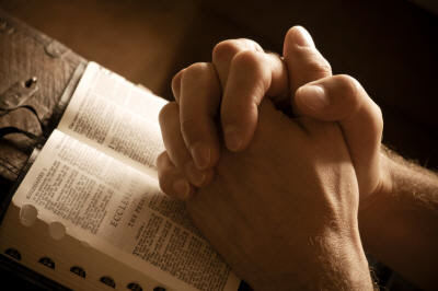 Praying Hands over Bible